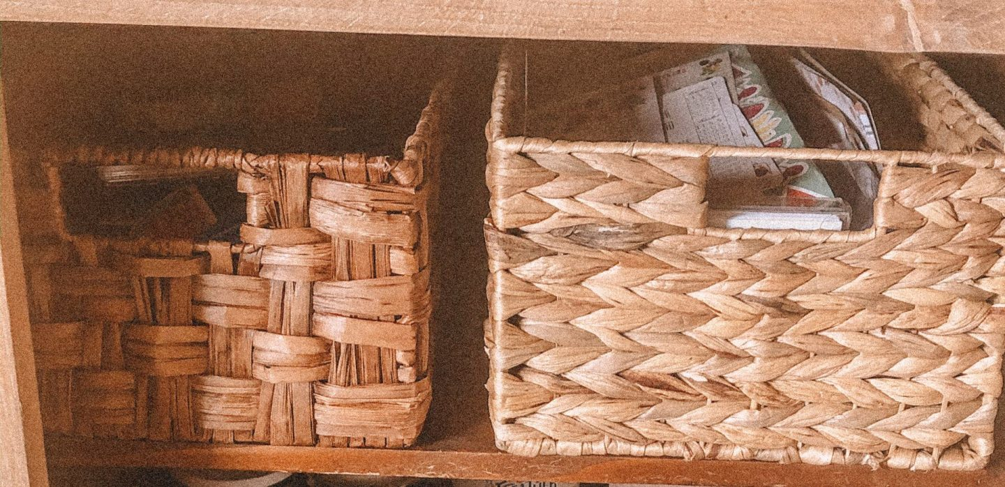 Two woven straw baskets